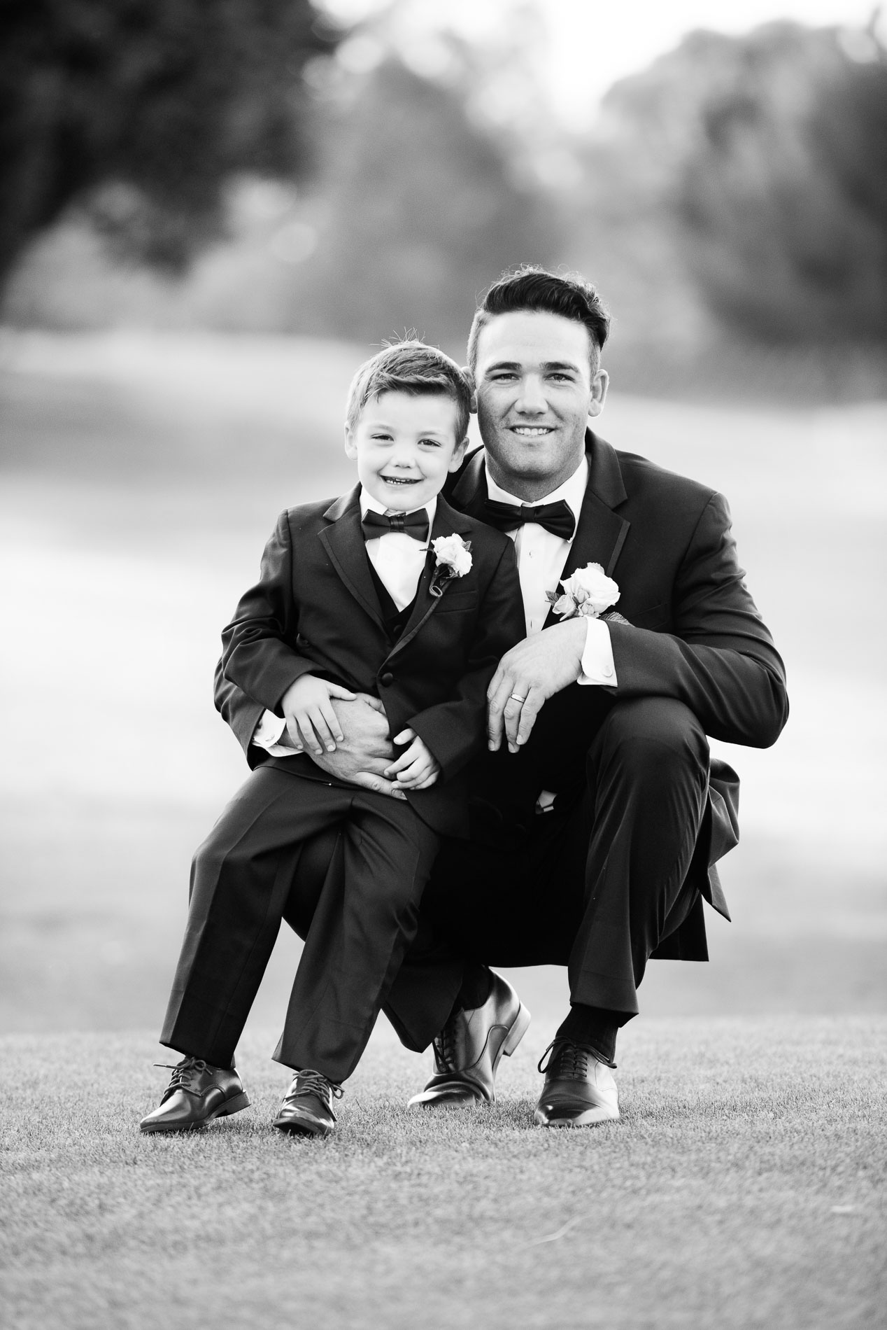 Special moment father son black and white wedding photo